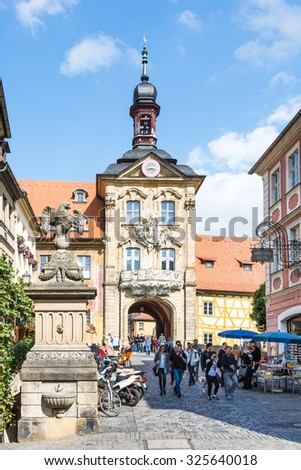 BAMBERG, GERMANY - SEPTEMBER 4: Tourists at Altes Rathaus in Bamberg, Germany on September 4, 2015. The historic town hall was built in the 14th century.  - stock photo