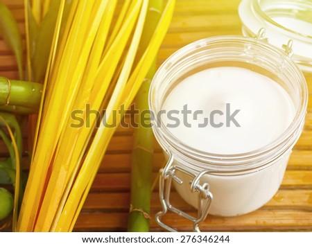 Bamboo and body milk - Spa still life  - stock photo