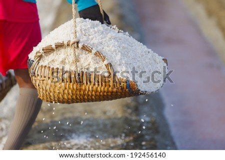 Bamboo basket and salt on the ground