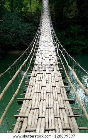 Bamboo bridge through the river in Philippines, natural bamboo bridge view close up, hand made bridge, bridge fragment, natural material view,