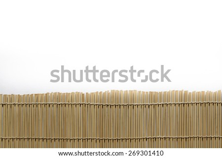 Bamboo brown straw mat on white paper as abstract texture background - stock photo