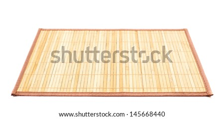 Bamboo brown straw serving mat isolated over white background - stock photo