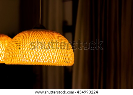 Bamboo ceiling light in living room, soft focus and dark tone  - stock photo