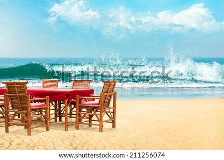 Bamboo chairs and table at tropical beach