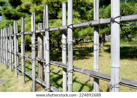 Bamboo fence in a Japanese garden - stock photo