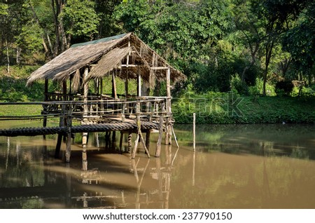 Bamboo flooring on the River - stock photo