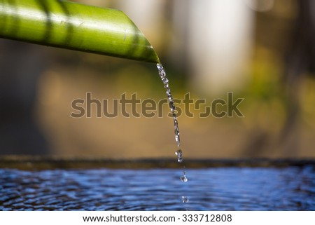 Bamboo fountain in japanese temple, Tokyo, Japan. - stock photo