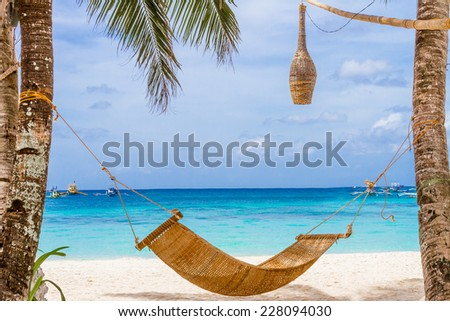 bamboo hammok on tropical beach and sea background, summer vacations