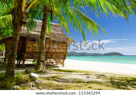 Bamboo hut on a tropical beach.