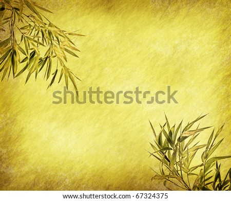 bamboo leaves on old grunge antique paper texture - stock photo