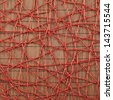Bamboo mat covered with the red threads as abstract background composition - stock photo