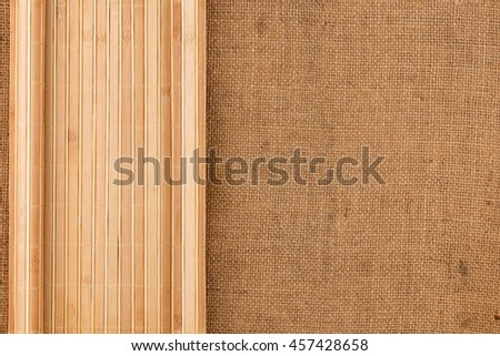 Bamboo mat twisted in the form of a manuscript on sackcloth, with space for your text