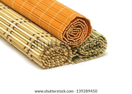 Bamboo mats on white background - stock photo