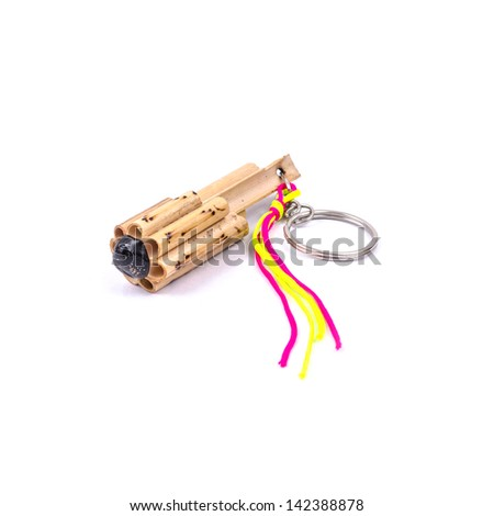 Bamboo Musical keychain from Thailand isolated on the white background. - stock photo
