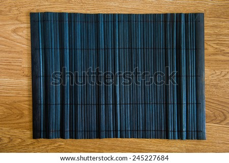 bamboo placemat straw wood on wooden background - stock photo