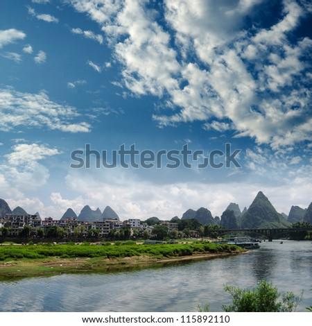 Bamboo raft at the Ulong river near Yangshuo, Guanxi province, China - stock photo