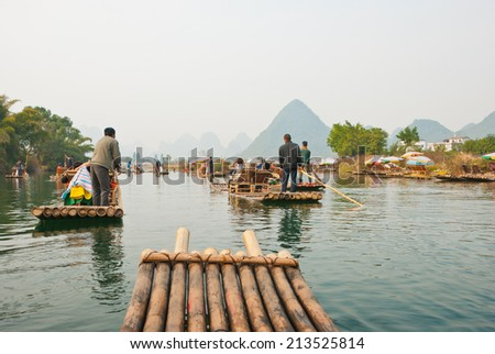 Bamboo raftign along YuLong, Guilin, China - Bamboo rafting along Yulong River during the winter season with beauty of the landscape is a popular activity in Guilin - stock photo