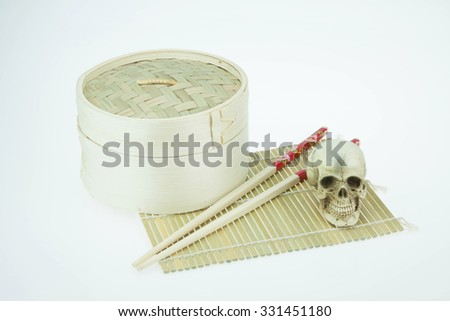 Bamboo round container shape and Skulls and Skulls. Concept of death with time and success - stock photo