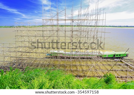 Bamboo scaffolding on a boat for Buddhist rituals. Steamer flow Nakhon Phanom, Thailand. - stock photo