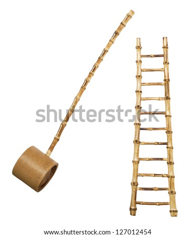 Bamboo stairs and ladle isolated on white background - stock photo