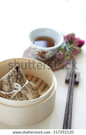 Bamboo steaming container with dumpling?_ - stock photo