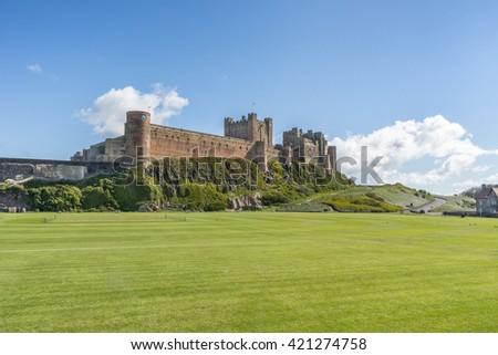 Bamburgh Castle on the Northumberland coast of England - stock photo
