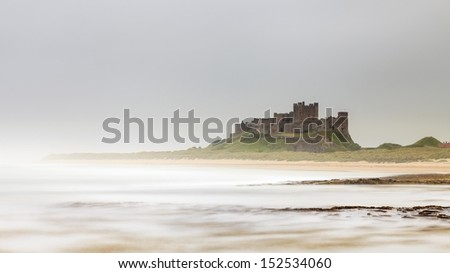 Bamburgh Castle.  The castle is situated in Northumberland on the north east coastline of England. - stock photo