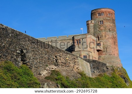 BAMBURGH, ENGLAND - JUNE 11: Castle on June 11, 2015 at Bamburgh, England. Bamburgh Castle is one of the most important medieval site of Northumberland.