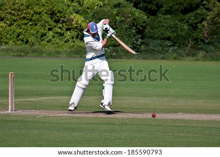 BAMBURGH, NORTHUMBERLAND/UK - AUGUST 15 : Playing cricket on the green at Bamburgh on August 15, 2010. Unidentified man.