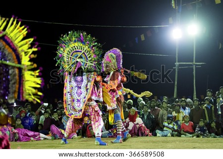 BAMNIA, PURULIA, WEST BENGAL , INDIA - DECEMBER 23RD 2015 : Dancer dressed as Hanumanji - a Hindu God , is killing a Demon in Chhau Dance. It is martial dance performed at night amongst spectators. - stock photo
