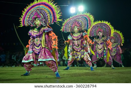 BAMNIA, PURULIA, WEST BENGAL , INDIA - DECEMBER 23RD 2015 : Four dancers performing at Chhau Dance festival. It is a very popular Indian tribal martial dance performed at night amongst spectators. - stock photo