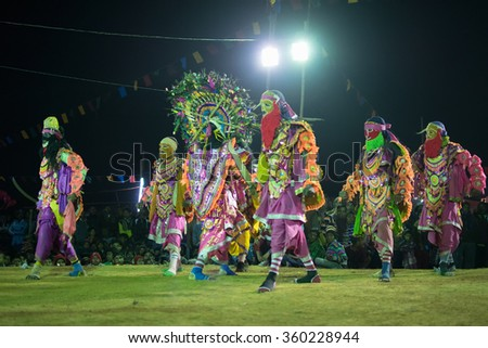 BAMNIA, PURULIA, WEST BENGAL , INDIA - DECEMBER 23RD 2015 : Group of dancers performing at Chhau Dance festival. It is a very popular Indian tribal martial dance performed at night amongst spectators. - stock photo