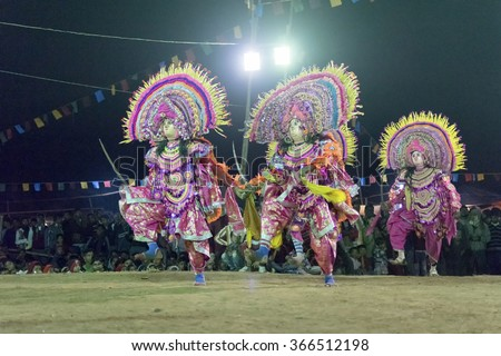 BAMNIA, PURULIA, WEST BENGAL , INDIA - DECEMBER 23RD 2015 : Three dancers performing at Chhau Dance festival. It is a very popular Indian tribal martial dance performed at night amongst spectators. - stock photo