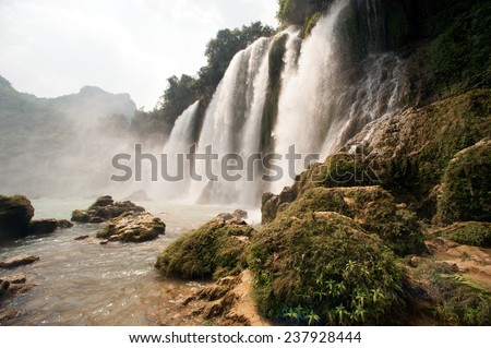 Ban Gioc Waterfall on the Quy Xuan River is located in Cao Bang Province,nears the Sino-Vietnamese border. The waterfall falls thirty meters. Located in Northern of Vietnam. - stock photo