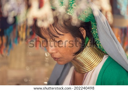 BAN NAI SOI, MAE HONG SON PROVINCE, THAILAND - FEBRUARY 6: Karen tribe woman with rings on neck in Ban Nai Soi, Thailand, February 6, 2014. Repression Karen in Myanmar forced them to flee to Thailand