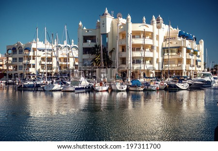 "BANALMADENA, SPAIN DEC 19, 2013:View of Puerto Marina, that has won the title of ""Best Marina in the World"" several times. It has a very unusual and modern architecture on 19 december, 2013 - stock photo"
