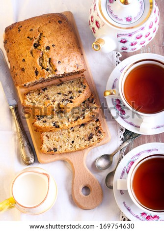 Banana and chocolate chips bread and tea, sliced - stock photo