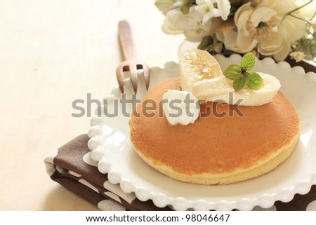 Banana and honey pan cake with Wooden spoon and flower