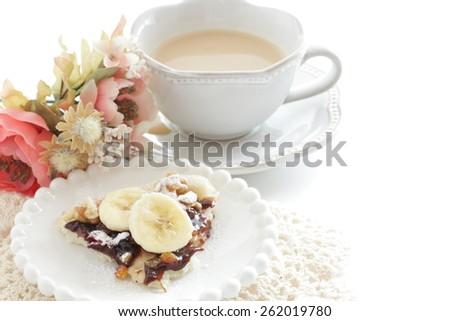 Banana and walnut chocolate Pizza and milk tea  - stock photo