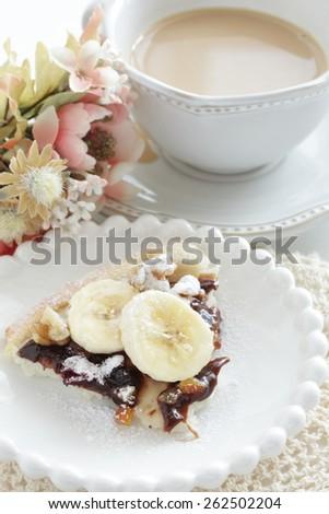 Banana and walnut chocolate Pizza with milk tea - stock photo