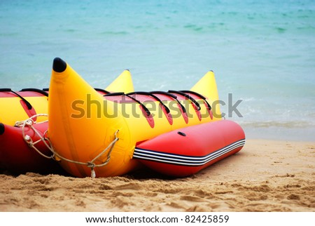 banana boat lays on a beach - stock photo