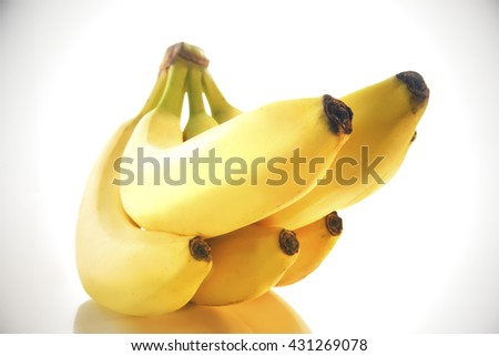 BANANA BUNCH WITH FIVE BANANAS , ISOLATED ON WHITE BACKGROUND WITH REFLECTION - stock photo