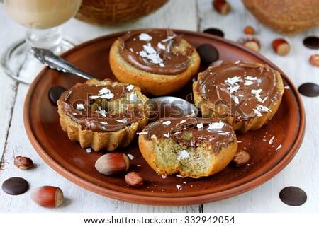 Banana buns with nut, coconut, chocolate paste - stock photo