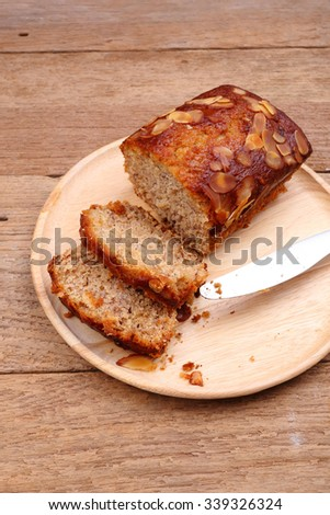 banana cake slice on wooden dish - stock photo