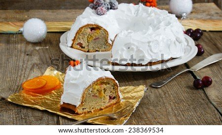 banana cake with cranberries and frosting - stock photo