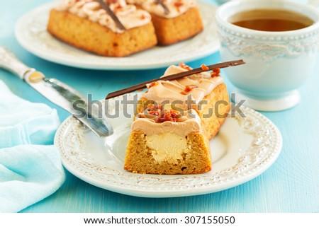 "Banana-caramel cupcakes with cream ""shibust."" Selective focus. - stock photo"