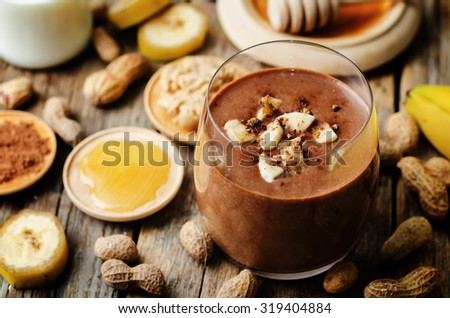 banana chocolate peanut butter smoothie. the toning. selective focus - stock photo