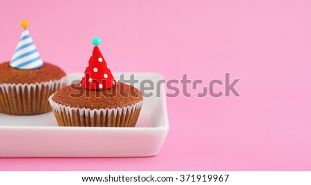 Banana cup cake on pink background