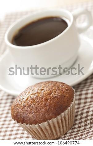 Banana cup cake with black coffee - stock photo