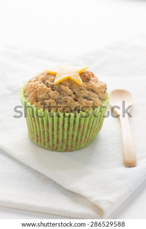 Banana cupcake with cheese on napkin - stock photo